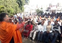 BJP State president, Ravinder Raina addressing an election meeting at R S Pura on Wednesday.