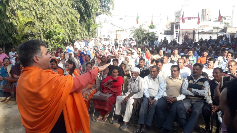 BJP State president, Ravinder Raina addressing an election meeting at R S Pura on Wednesday.