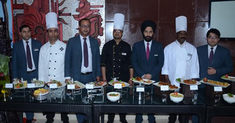 Chefs and officials of Hotel KC Residency displaying a variety of cuisines on the launch of Lucknowi Food Festival.