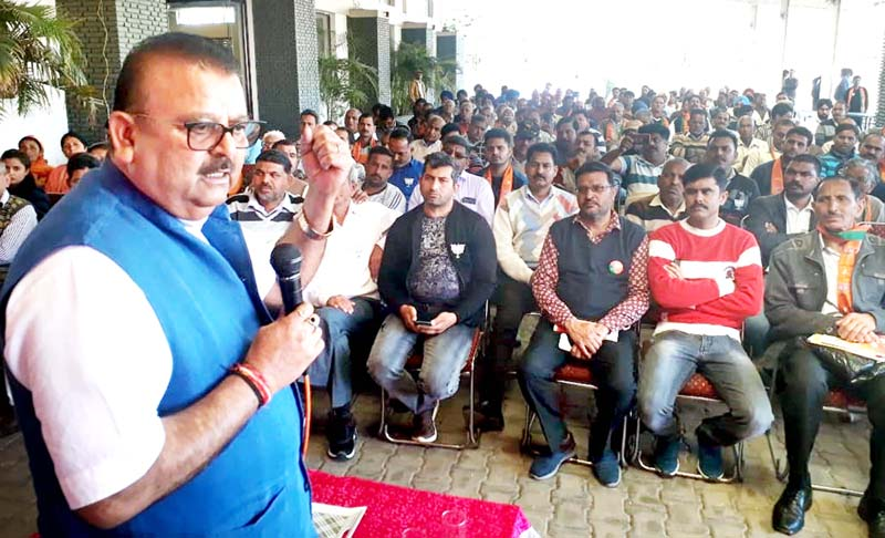 Former Minister, CP Ganga addressing a meeting at Vijaypur on Friday.