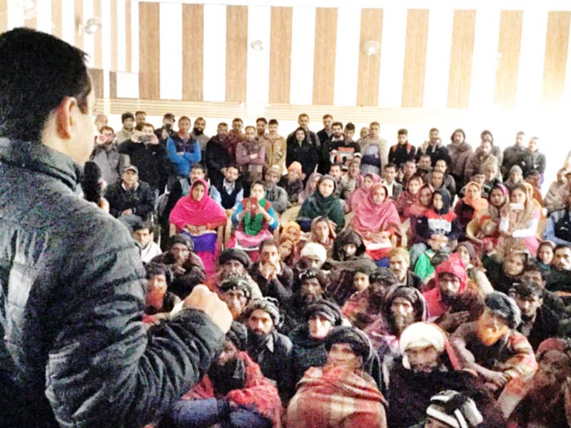 R S Pathania addressing a public meeting at Ramnagar.