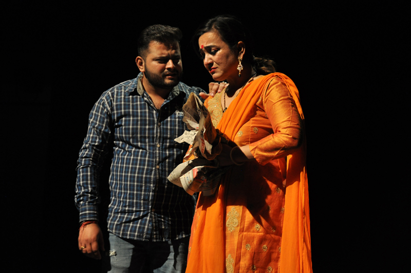 A scene from Jagdeep Dubey's Dogri play Amma, staged at Abhinav Theatre on Friday. -Excelsior/Rakesh