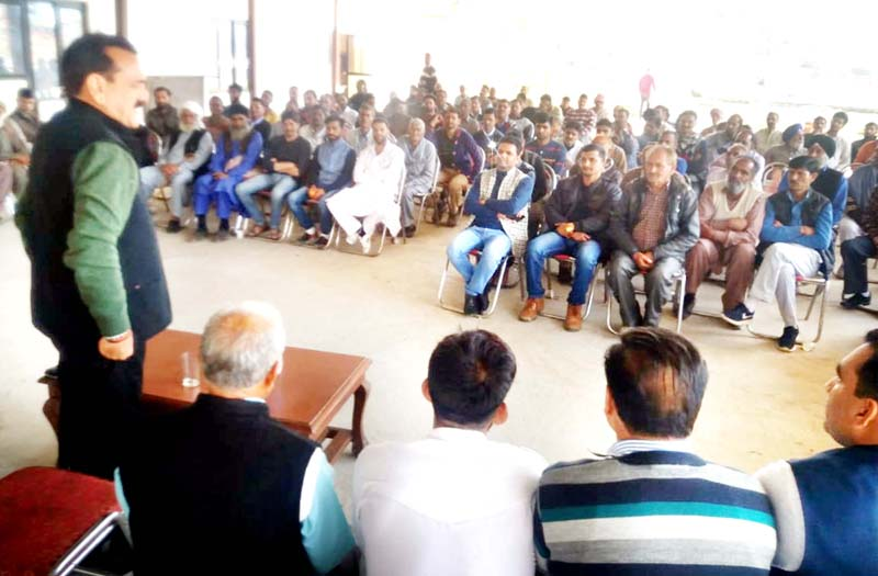 Senior Cong leader Jugal Kishore addressing workers' meeting at Pouni in Reasi.