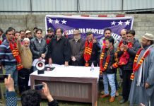 Peoples Conference chairman Sajjad Gani Lone addressing workers' meeting in Srinagar.