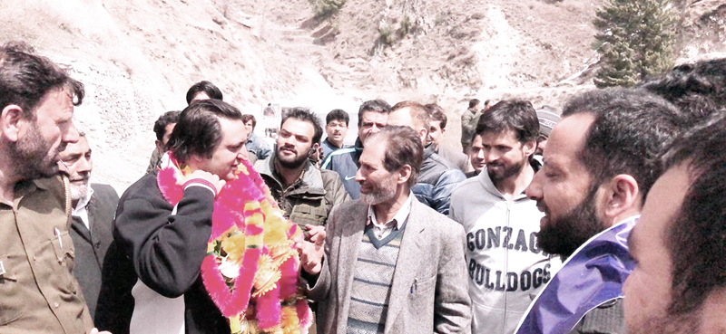 Sajad Lone meeting people during election campaign on Wednesday.