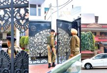 Security personnel guarding premises being raided by IT sleuths in Gandhi Nagar area on Thursday. -Excelsior/Rakesh