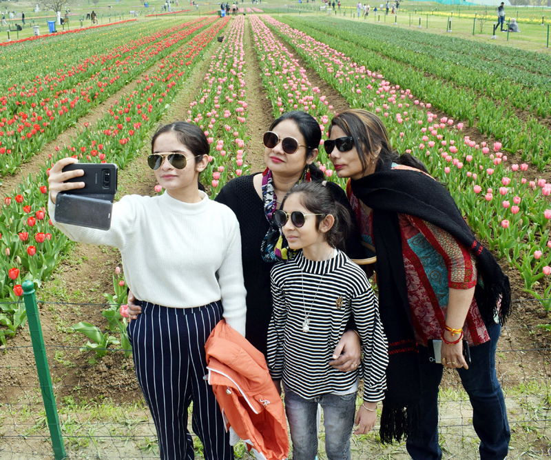 Visitors at Asia's largest Tulip Garden in Srinagar on Sunday. —Excelsior/Shakeel