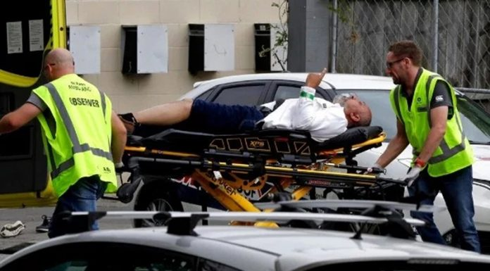 An injured person is loaded into an ambulance following a shooting at the Noor mosque in Christchurch, New Zealand.