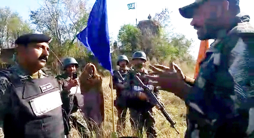 The BSF handing over Pakistani national to Rangers at the International Border on Saturday.