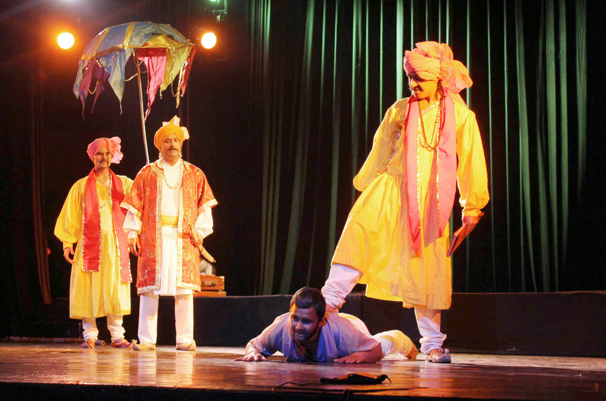 A scene from Dogri play 'Bawa Jit Mal' staged at Abhinav Theatre on Monday. -Excelsior/Rakesh