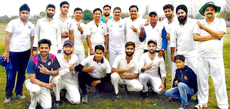 Reader's Cafe Cricket Club players posing for a group photograph after registering win.