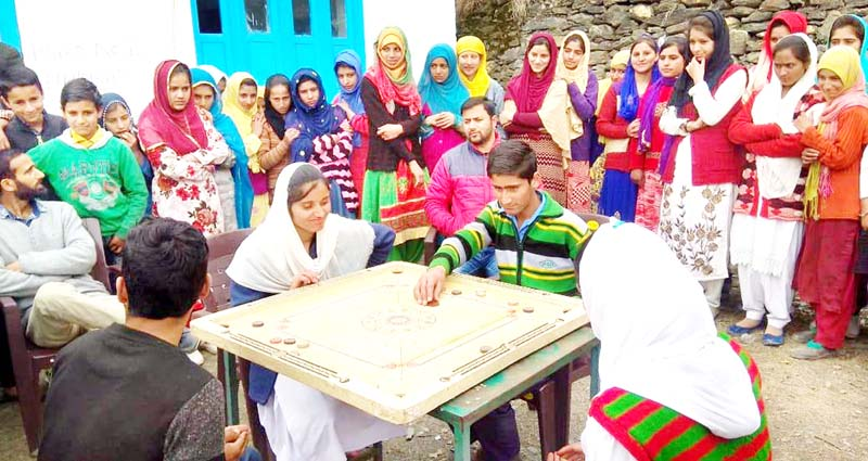 Players in action during Carrom competition organised by Army in Kishtwar.
