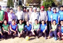 Players posing for a group photograph on the inaugural ceremony of 16th Bhai Gurbax Singh Memorial State Korfball Championship in Jammu on Saturday.