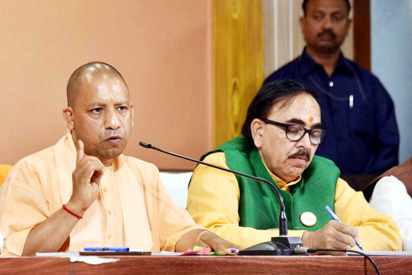 Uttar Pradesh Chief Minister Yogi Adititynath addressing press conference on completing two years of his government at party office in Lucknow on Tuesday. (UNI)