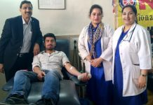 A volunteer donating blood at a camp in Jammu on Tuesday.