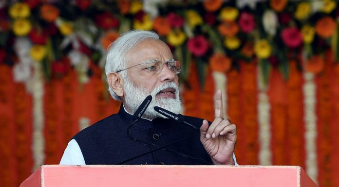 Prime Minister Narendra Modi addressing the public at Kanpur in Uttar Pradesh on Friday. (UNI)
