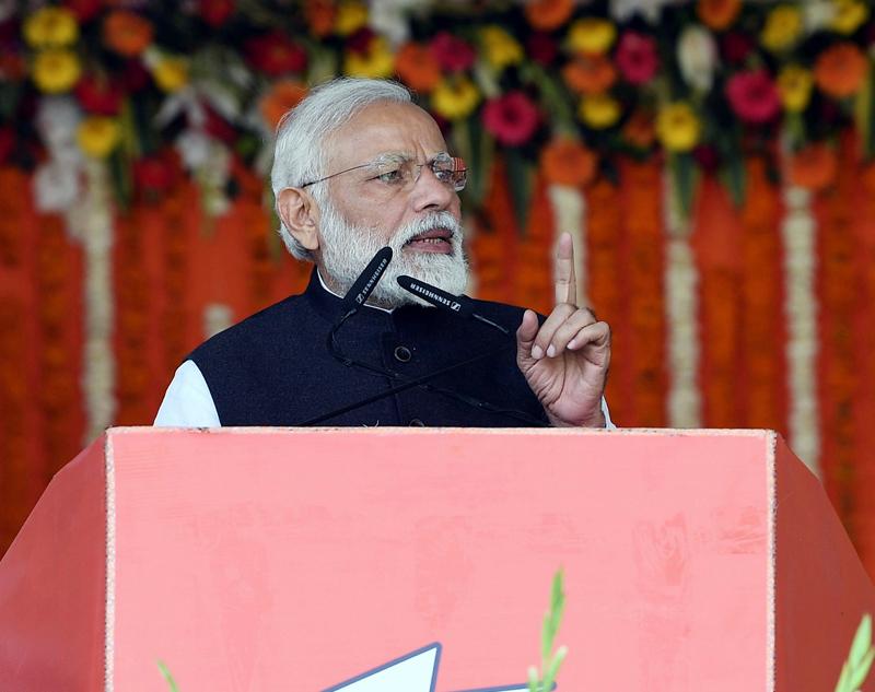 Prime Minister Narendra Modi addressing the public at Kanpur in Uttar Pradesh on Friday. (UNI)