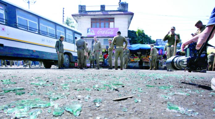 Splinters of the grenade and wind screens of damaged vehicles at General Bus Stand Jammu on Thursday. -Excelsior/Rakesh