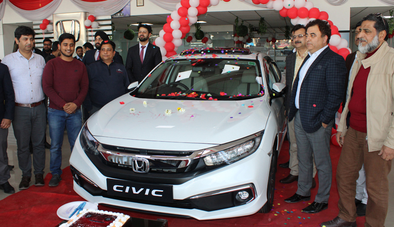 Dignitaries posing for photograph after unveiling All-New 10th Generation Honda Civic. -Excelsior/Rakesh