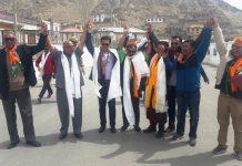 Union MoS Home Kiren Rijiju, BJP leader Avinash Rai Khanna and CEC Jamyang Tsering Namgayal raise hands after filing nomination papers in Leh on Tuesday. —Excelsior/Morup Stanzin
