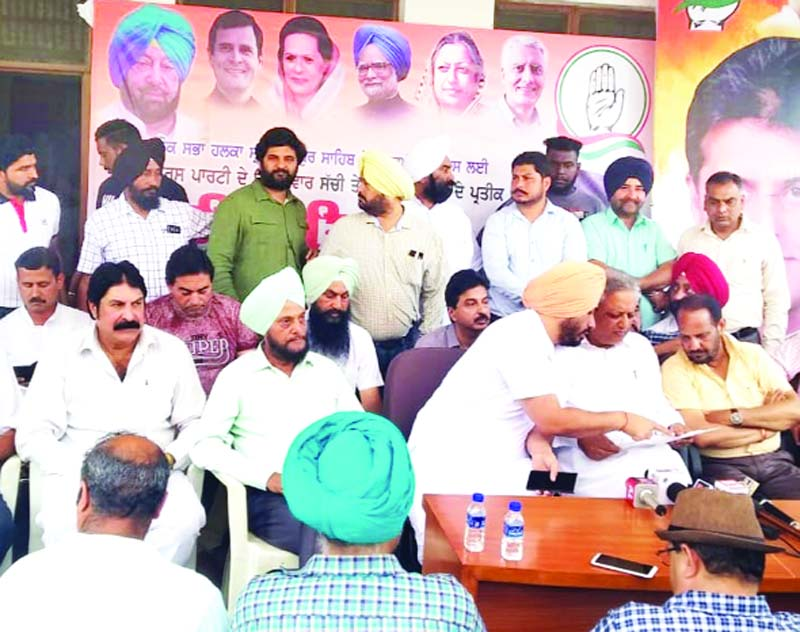 Yogesh Sawhney alongwith other Congress leaders at PCC office in Punjab on Thursday.