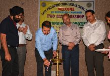 Director Technical Education lighting ceremonial lamp during inaugural of two-day workshop at Govt Polytechnic Jammu on Wednesday.