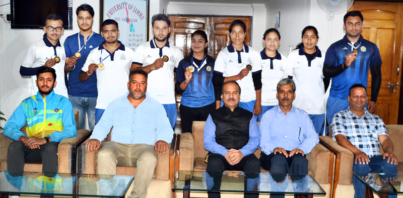 Medal winners of Pencak Silat Championship posing along with dignitaries and officials at JU in Jammu on Wednesday.