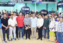 Players posing along with dignitaries, officials and organisers during inaugural ceremony of Wushu Championship in Jammu.