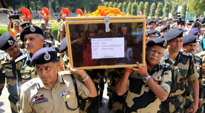 DG BSF R K Mishra lends a shoulder to the mortal remains of BSF Inspector T Alex Lalminlum at BSF Headquarters at Paloura on Tuesday.