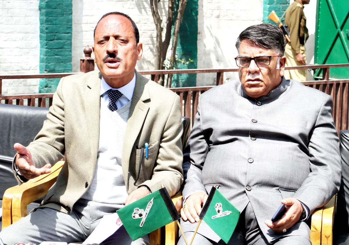 PDP general secretary Abdul Haq Khan and MLC Mohd Khurshid Alam addressing a joint press conference in Srinagar.
