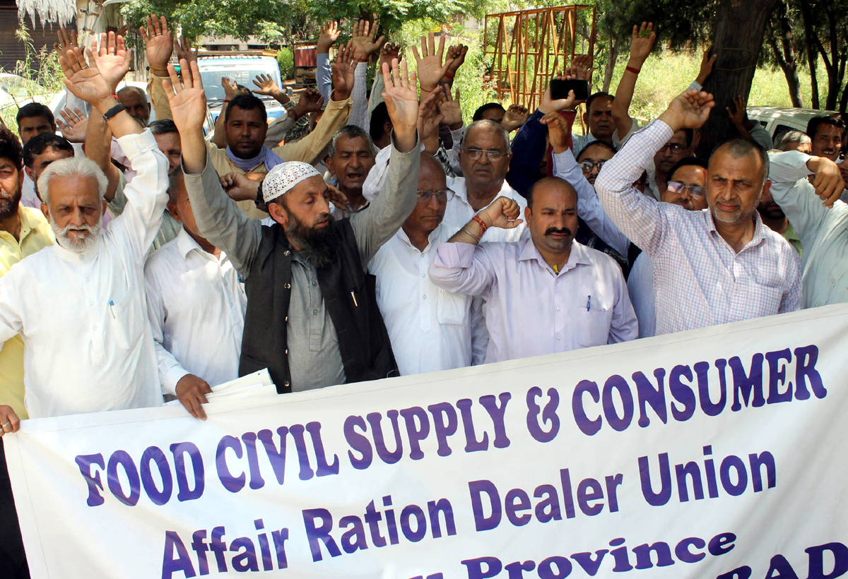 Ration dealers of FCS&CA Department taking out a protest in Jammu on Monday.