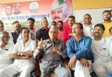 Senior Congress leader and former MP Dr Karan Singh addressing a public meeting at Hiranagar in Kathua district.