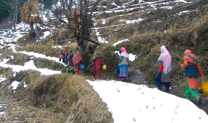 Womenfolk of Ganori and adjoining villages of Kahara tehsil of Doda climbing a mountain to fetch potable water from a natural fountain.