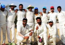 Jubilant Simula Cricket Club players posing for a group photograph after win against KCCC in Jammmu on Friday.