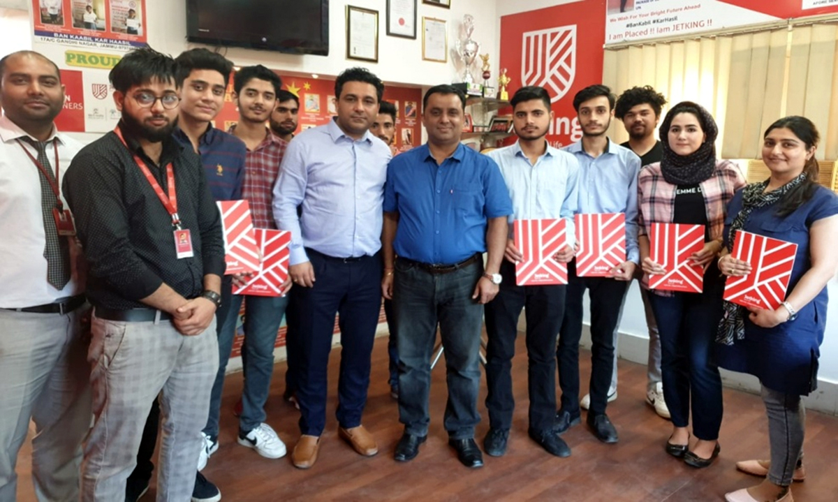 Directors of Jetking Jammu, Amit Kaushal and Naveen Sharma, posing with students placed in various IT companies.