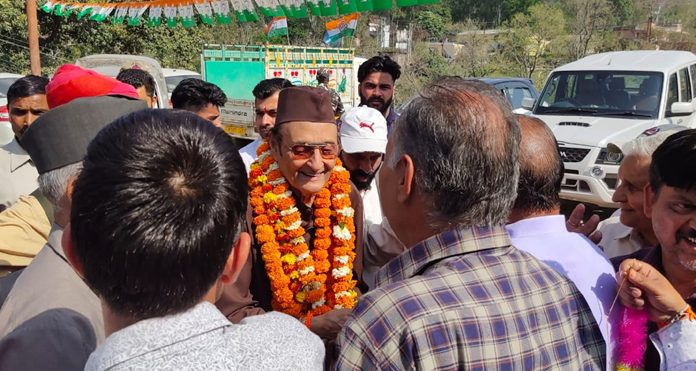 Dr Karan Singh interacting with people during election campaigning in Kathua district on Monday.