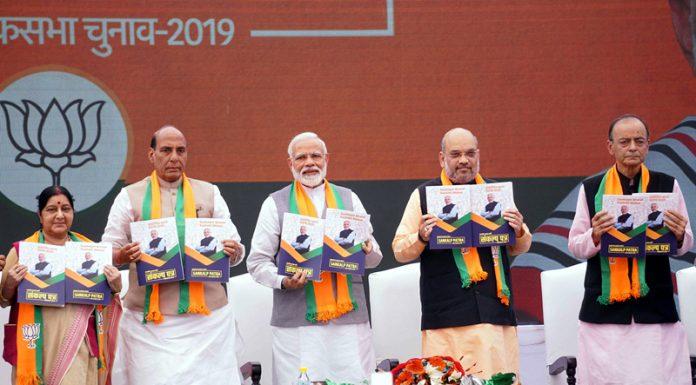 Prime Minister Narendra Modi, BJP president Amit Shah, Union Finance Minister Arun Jaitley, Union Home Minister Rajnath Singh and External Affairs Minister Sushma Swaraj releasing the BJP manifesto- 'Sankalp Patra' for Lok Sabha Elections-2019, in New Delhi on Monday. (UNI)