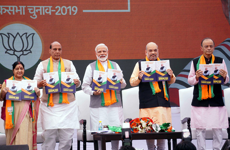 Prime Minister Narendra Modi, BJP president Amit Shah, Union Finance Minister Arun Jaitley, Union Home Minister Rajnath Singh and External Affairs Minister Sushma Swaraj releasing the BJP manifesto- 'Sankalp Patra' for Lok Sabha Elections-2019, in New Delhi on Monday. (UNI)