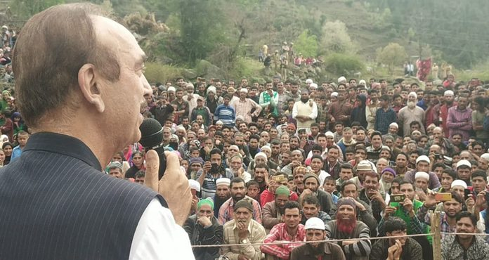 Senior Congress leader Ghulam Nabi Azad addressing an election rally at Latti in Udhampur district on Friday.