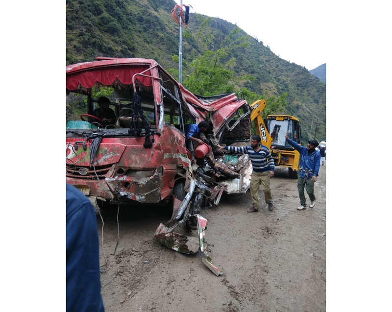 Wreckage of mini-bus, which came under boulder after landslide near Piyakul area on Thathri-Gandoh road in Doda on Wednesday. —Excelsior/Rafi Choudhary