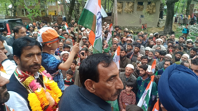 Congress candidate, G A Mir during road show in Devsar area of Kulgam on Thursday. -Excelsior/Sajad Dar