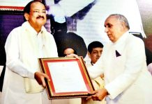 Prof Pritam Chander Shastri receiving award from Vice-President, M. Venkaiah Naidu in New Delhi.