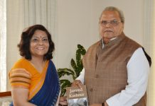 Governor Satya Pal Malik receiving book from Prof Abha Chauhan.
