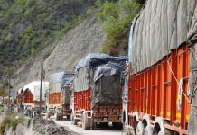 Trucks stranded on highway near Ramban on Thursday. — Excelsior/Parvez Mir