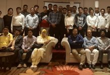 Assistant Commissioner, Food Safety, Jammu Municipal Limits, and his team posing with food handlers of various hotels during a workshop at Jammu.