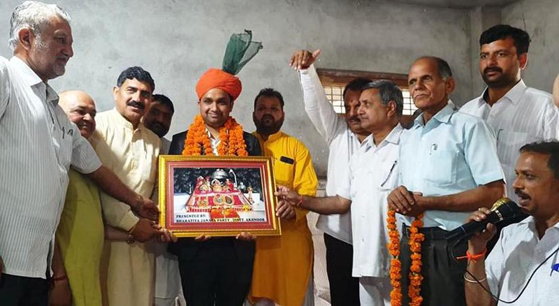 BJP leaders presenting a memento to first IAS officer from Akhnoor, Ankush Bhagat on Thursday.