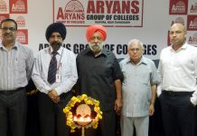 Dignitaries inaugurating a seminar at Aryans College on Wednesday.