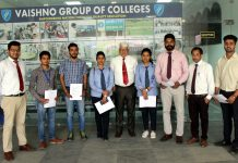 Selected students with company representatives, Director and TPO of the College.
