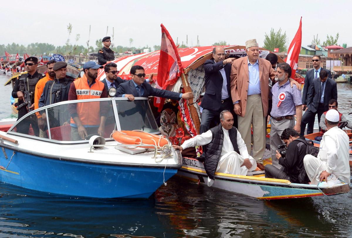 National Conference President Dr Farooq Abdullah during Shikara rally at world famous Dal lake in Srinagar. -Excelsior/Shakeel