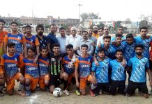 Young footballers posing along with dignitaries and officials during inaugural ceremony of 1st Arun Sharma Memorial Football Tournament in Jammu.